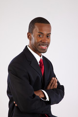 Black businessman with arms folded