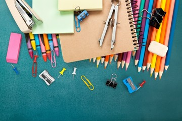 School. School supplies on blackboard background ready for your