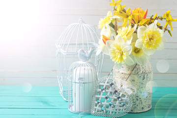 Background with fresh daffodils  and decorative heart