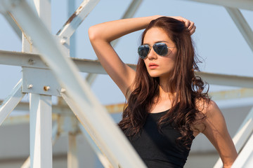 sporty woman looking out sun glasses