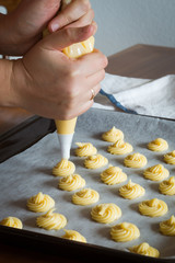 Piping Choux Paste for Cream Puffs onto Parchment-lined Pan