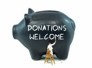 Donations Welcome message painted on a piggy bank