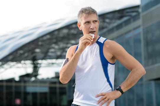 Man Eating Energy Bar
