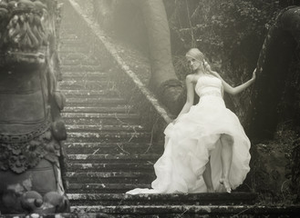 retro image of bride in fairy park in Bali
