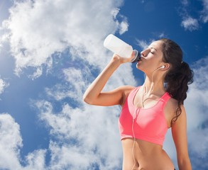 Composite image of beautiful healthy woman drinking water