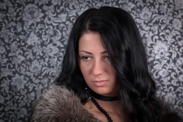 Beautiful woman retro portrait in fur