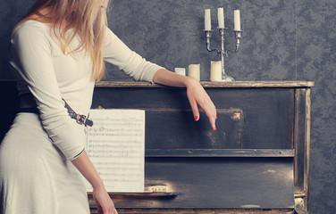 woman near a piano