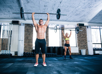 Group of woman and man workout with barbell