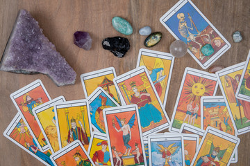Esoteric table with  tarots, healing stones