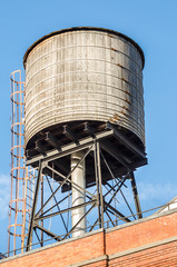 Rooftop Water Tank against Blue Sky