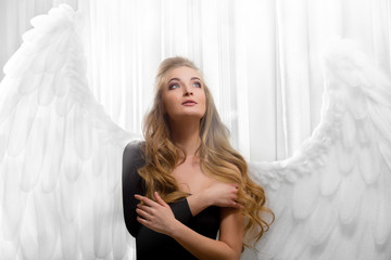 Gorgeous girl with big, white wings