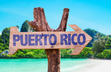 Puerto Rico wooden sign with beach background