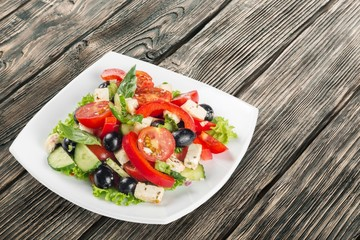 Wall Mural - Salad. Greek Salad - Feta Cheese, Olive and Vegetables, isolated