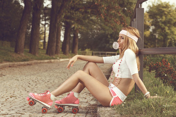 Sexy woman with roller skates