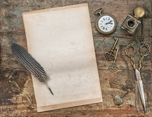 Letter paper with vintage writing tools. Feather pen and inkwell