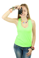 young girl with camera in hand taking pictures