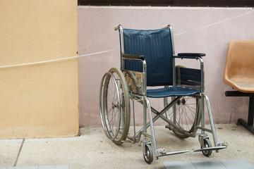 wheelchair beside the wall