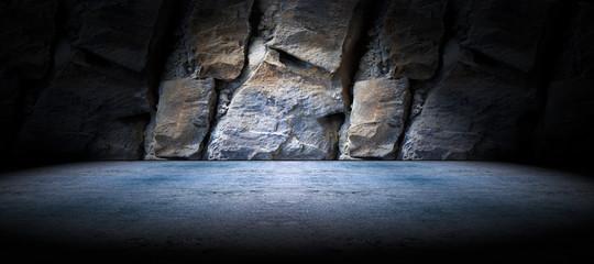 Fondo suelo de cemento y pared de roca