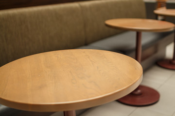 part of a circular table in a coffee bar