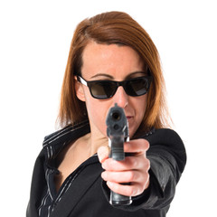 Business woman shooting with a pistol