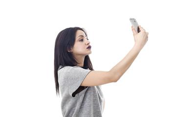 Beautiful woman profile portrait taking a selfie