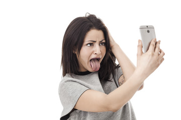Funny woman making a grimace and taking a selfie