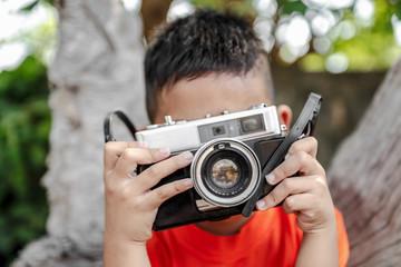 boy with old camera retro