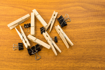 Group of Black Clip and Wood Clothespins with Random Pattern