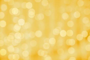 Fotobehang - blurred golden background with bokeh lights