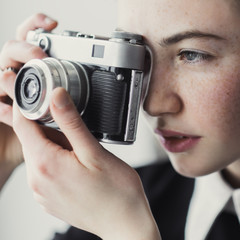 wonderful girl with freckles and vintage camera