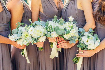 bridesmaids in brown with wedding bouquet