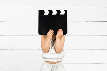 Kid with clapper board