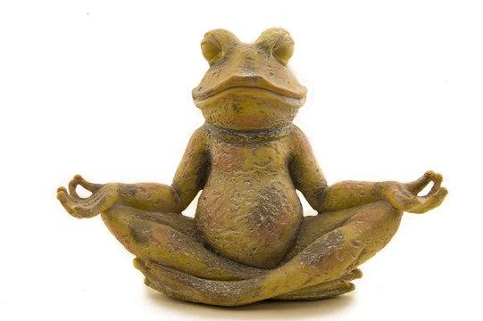 stone frog meditates on a white background