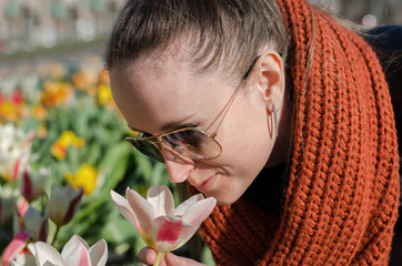 girl smelling a tulip