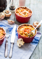Baked mushroom julienne potatoes and tomato with cheese, lunch