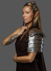 Beautiful elf woman on grey background