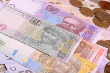 Pile of Ukrainian money, isolated on white