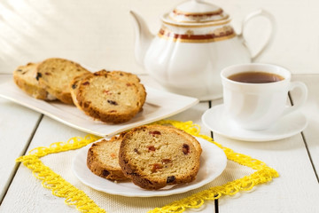 Cake with raisins, teapot and a cup of tea