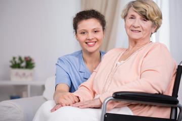 Woman sitting on a wheelchair