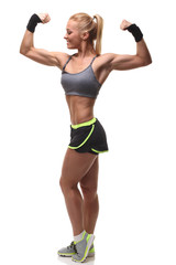 Attractive athletic girl showing biceps
