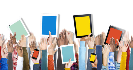 Group of Hands Holding Digital Devices Concept