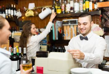 Girl flirting with barman at counter