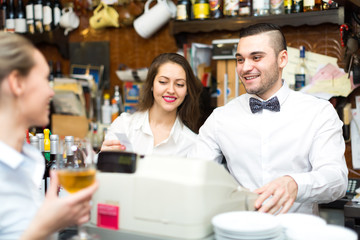 People working in a bar