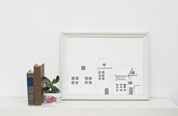 Picture frame with small houses