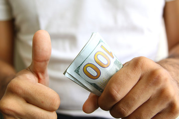 Winner showing profits. spread of cash.