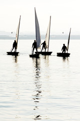 children return to navigate in their optimist and 4.70 sailboats