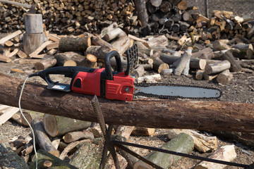Timber cutting wood with old electric saw, chainsaw and blade.
