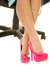 woman legs in pink heels and blue dress sitting feet crossed