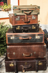 Old vintage used leather stacked suitcases