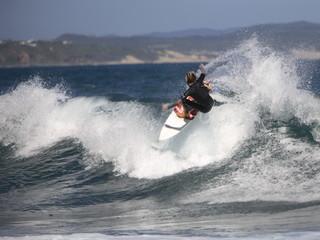 Adrenaline seeking surfer surfing in the ocean